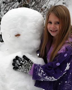 Emily hugs her snowman