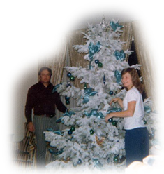 Kristin and dad decorate the tree